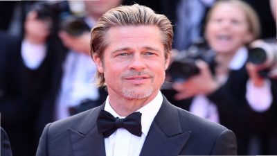 Brad Pitt's man bun is a hit at the Oscars